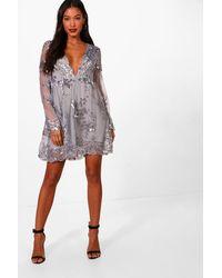 5ff0887f8377 Boohoo Ellie Sequin And Mesh Long Sleeve Skater Dress in Metallic - Lyst