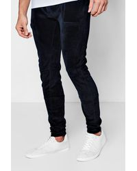 Boohoo Black Skinny Fit Velour Joggers With Overlock Stitching for men