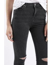 TOPSHOP Moto Washed Black Ripped Jamie Jeans