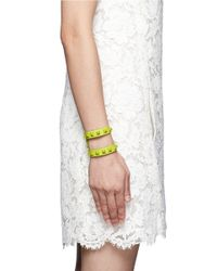 Valentino - Yellow Rockstud Cutout Leather Bracelet - Lyst