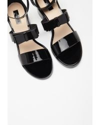 Forever 21 Black Faux Leather Bow Sandals