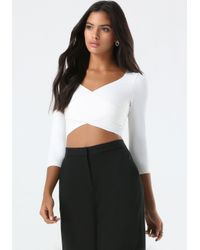 Bebe | White 3/4 Sleeve Wrap Crop Top | Lyst