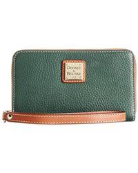 Dooney & Bourke | Green Zip Around Carryall Wristlet | Lyst