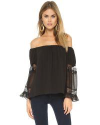 T-bags | Ruffle Sleeve Blouse - Misty Black | Lyst