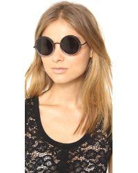 The Row Gray Round Sunglasses - Molasses/Brown