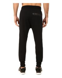 PUMA | Black Evo Sweat Pants for Men | Lyst