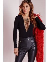 Missguided - Lace Up Long Sleeve Bodysuit Black - Lyst