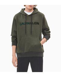 Calvin Klein Green Flock Print Logo Hoodie for men