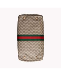 Gucci Natural Travel Bag In Beige And Ebony GG Supreme Fabric With Brown Leather Trim With Green And Red Web Ribbon