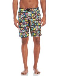 e9d0a82ab32 Lyst - Moschino Mare Logo Board Shorts in Blue for Men