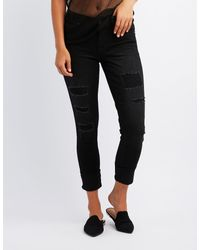 Charlotte Russe - Black Destroyed Push-up Skinny Jeans - Lyst