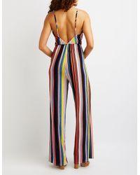 Charlotte Russe - Blue Striped Wrap Jumpsuit - Lyst