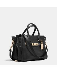 COACH | Black Swagger 27 In Pebble Leather | Lyst