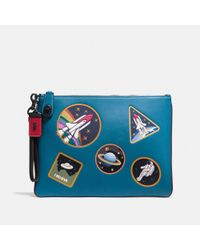 COACH Blue Turnlock Wristlet 30 With Space Patches