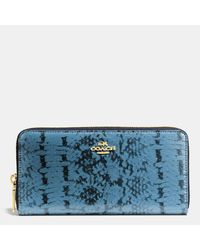 COACH | Blue Accordion Zip Wallet In Colorblock Exotic Embossed Leather | Lyst