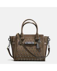 COACH | Brown Swagger 21 In Pebble Leather With Ombre Rivets | Lyst