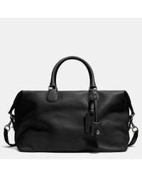 COACH | Black Explorer Bag In Pebble Leather | Lyst