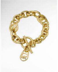 Michael Kors | Metallic Goldplated Logo Lock Charm Bracelet | Lyst