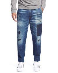 DIESEL Blue 'carrot' Slim Fit Shredded Jeans for men