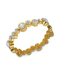 T Tahari - Metallic Goldtone Staggered Crystal Stretch Bracelet - Lyst