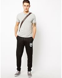 ASOS - Black Skinny Sweatpants in All Over Mesh with Sports Print for Men - Lyst