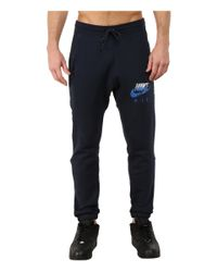 Nike | Blue Aw77 Fleece Cuff Pants Hybrid for Men | Lyst