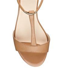 Nine West | Natural Ukie Leather Open-Toe T-Strap Sandals | Lyst