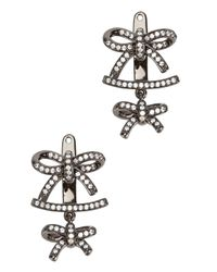Fallon - Black Forget Me Knot Earrings - Lyst