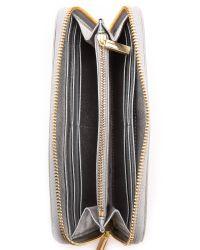 Tory Burch - Robinson Metallic Zip Continental Wallet Silver - Lyst