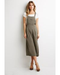 0314bd32e644 Lyst - Forever 21 Contemporary Pleated Wide-leg Overalls in Green