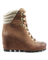 2ae94229c53 Sorel Conquest Tan Lace Up Wedge Boot in Brown - Lyst