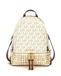Lyst - MICHAEL Michael Kors Rhea Signature Studded Backpack in Brown 4ec726cd3677e