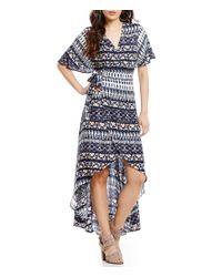 Jessica Simpson | Blue Amethyst Printed V-neck High-low Wrap Maxi Dress | Lyst