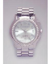 Bebe Metallic Floating Crystal Logo Watch
