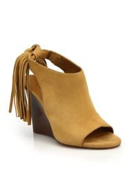 f5bd7bcb351 Lyst - Chloé Fringed Suede Peep-toe Wedge Sandals in Natural