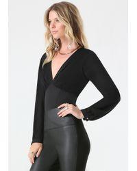 Bebe - Black Plunge Neck Bodysuit - Lyst