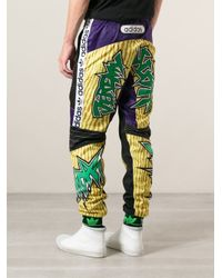Adidas Multicolor Jeremy Scott Printed And Patch Embroidered Track Trousers for men