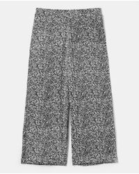 Pantalón Fluido De Mujer Talla Grande Con Flores Woman El Corte Inglés de color Black
