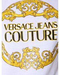 T-SHIRT GIROCOLLO IN COTONE CON STAMPA di Versace Jeans in Black