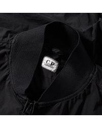 C P Company Black Nycra Stretch Arm Lens Bomber Jacket for men