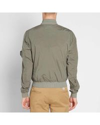 C P Company Green Nycra Stretch Arm Lens Bomber Jacket for men