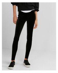 5dcfe1ef57492c Lyst - Express Petite Mid Rise Velvet Leggings in Black
