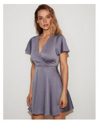 Express Blue Satin Surplice Flutter Sleeve Fit And Flare Dress