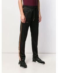 Pantalon de jogging Ali Marcelo Burlon pour homme en coloris Black