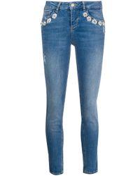 Jean skinny à fleurs brodées Liu Jo en coloris Blue