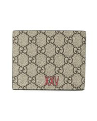 Gucci Brown Signature Wolf Wallet