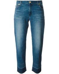 Released-hem straight-leg jeans di MICHAEL Michael Kors in Blue