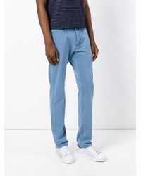 Edwin Blue Striped Tapered Trousers for men