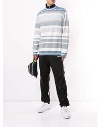 Pantalon de jogging fuselé Palace pour homme en coloris Black