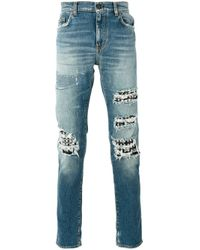 Jeans effetto vissuto di Saint Laurent in Blue da Uomo